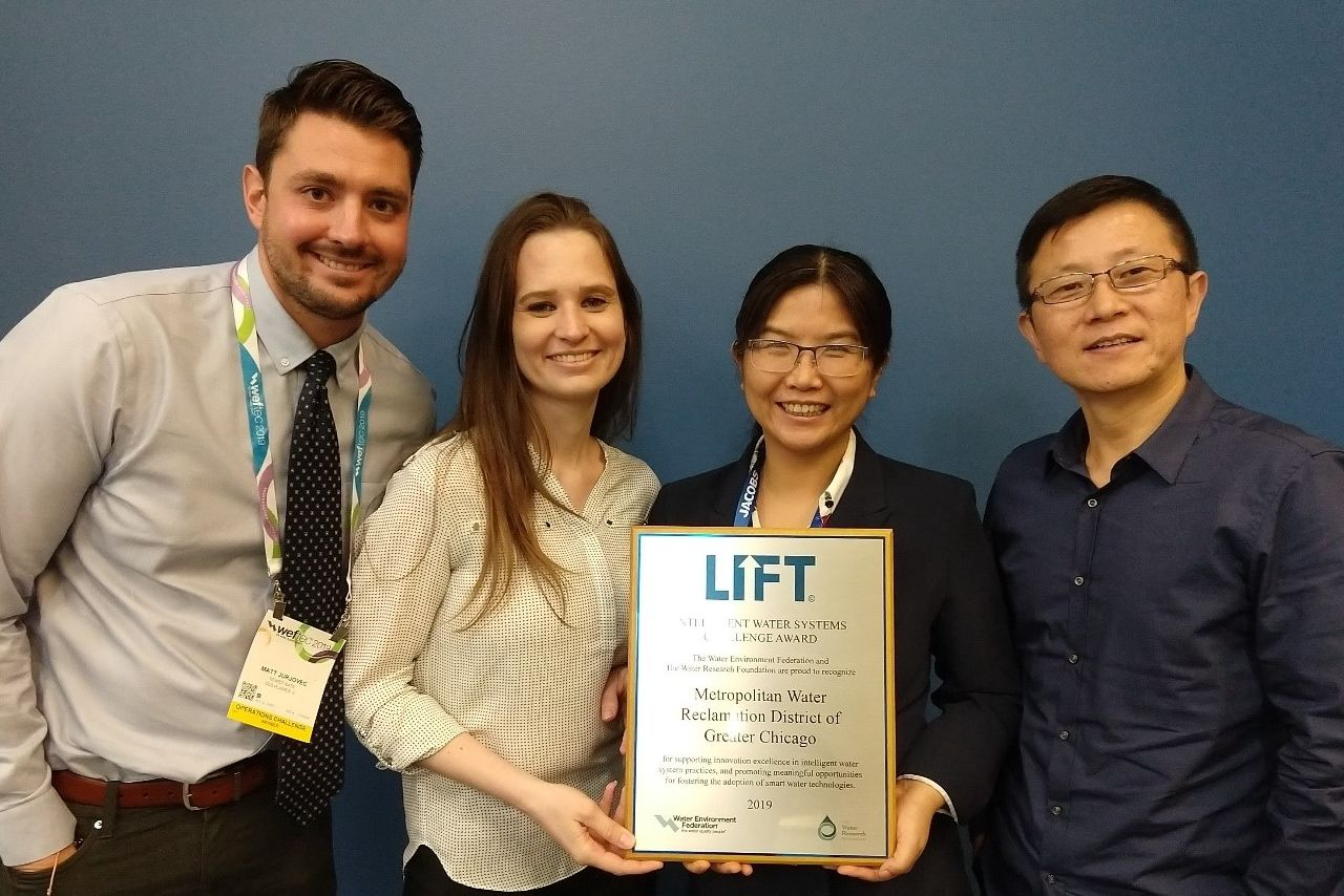 MWRD Senior Engineer Matt Jurjovec (left), MWRD Environmental Research Scientist Thais Pluth, MWRD Senior Environmental Research Scientist and team leader Fenghua Yang, and Illinois State University Professor Yongning Tang celebrate their award-winning presentation.