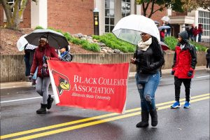 students walking with parade banner