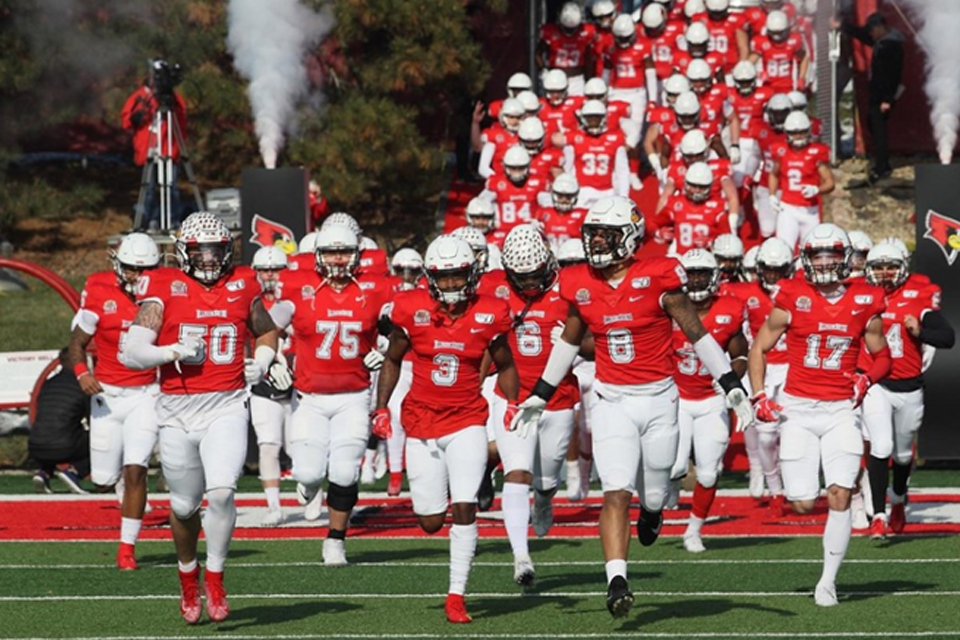 football team running onto field
