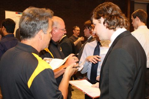 Students talking to job recruiters
