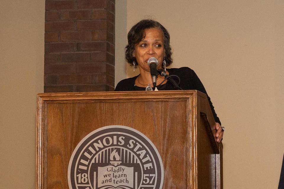 woman speaking into mic at podium