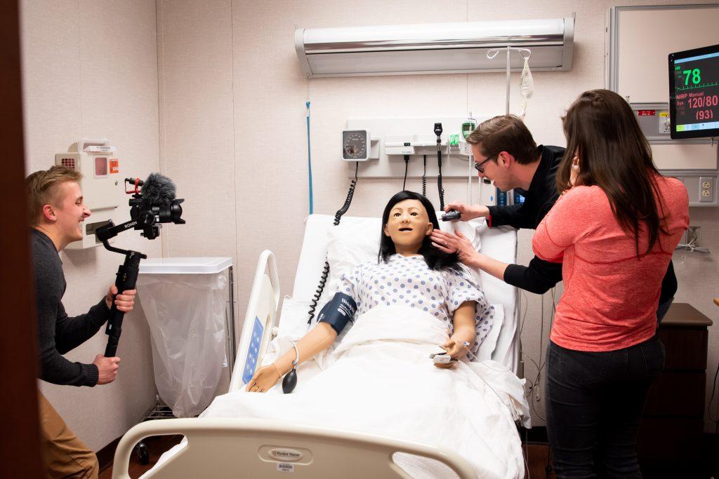 Keith Habersberger practices nursing on simulation manikin