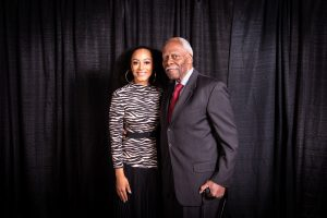 Angela Rye standing next to Andrew Purnell