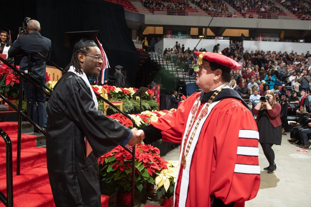President Dietz with graduating student.