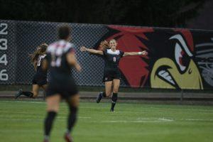 Woman celebrates goal