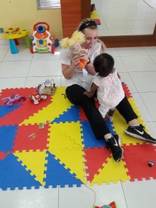 Senior nursing major Kate Vandervest interacted with a child during a site visit arranged in Panama.
