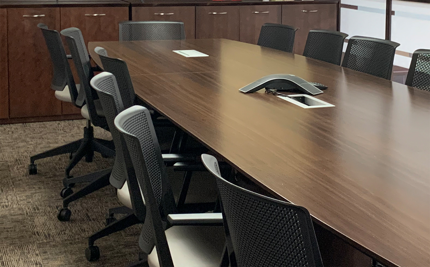 image of a table and chairs in meeting room