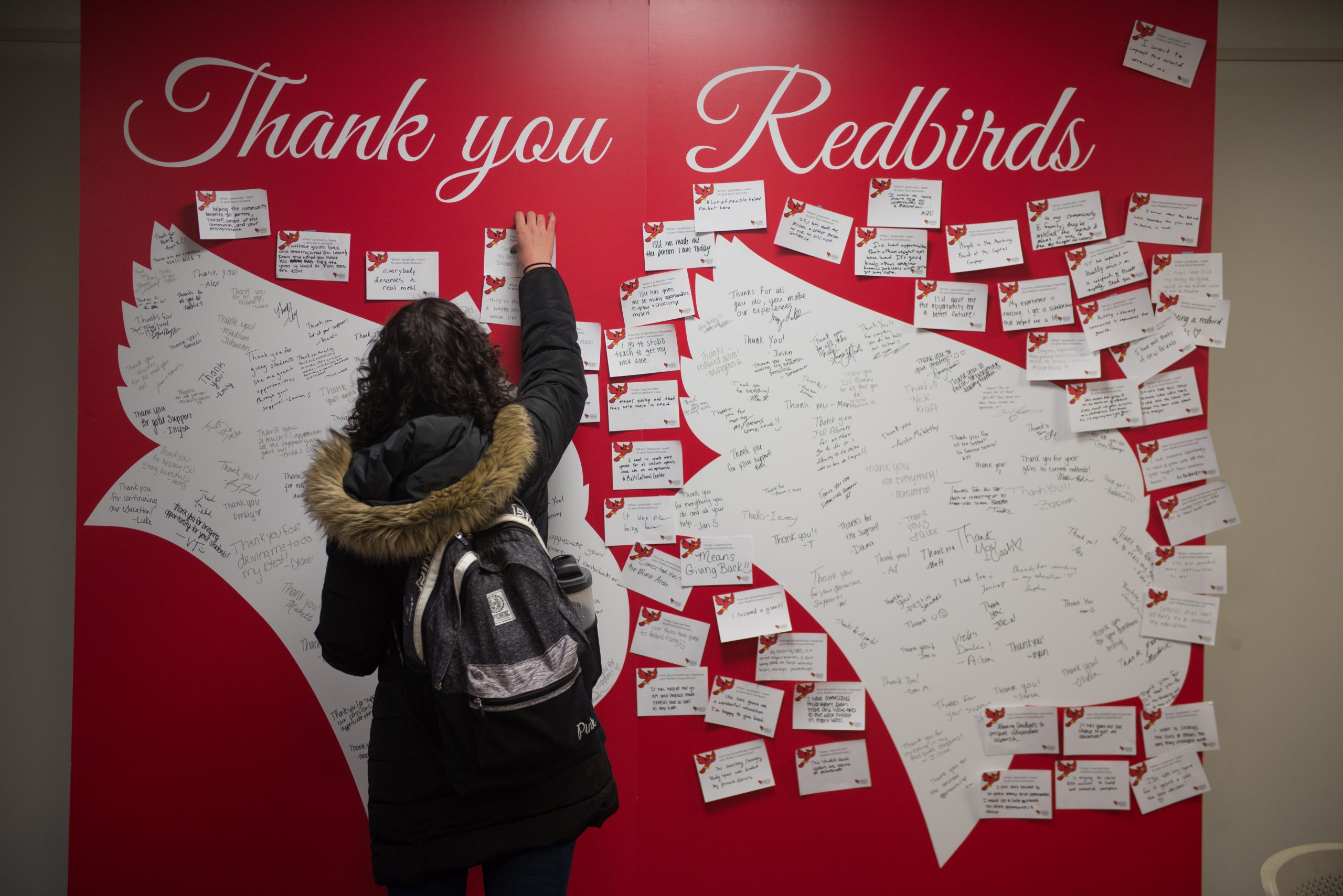 Student writes thank you message to donors during Redbird Philanthropy Week