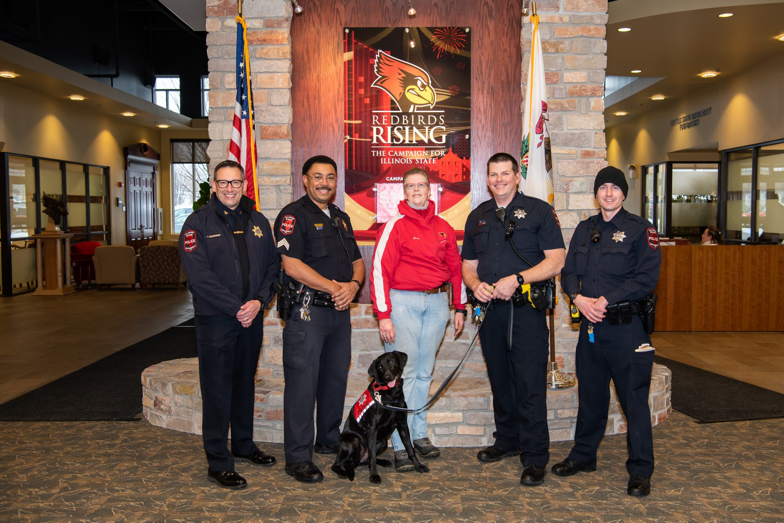 Susan Cameron standing alongside Illinois State University Police Chief Aaron Woodruff and the Community Engagement Unit.