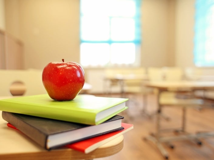 apple on books in a classroom