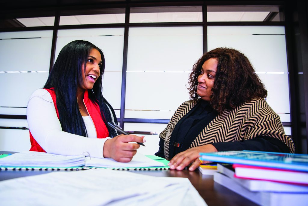 Two women organizing a program together