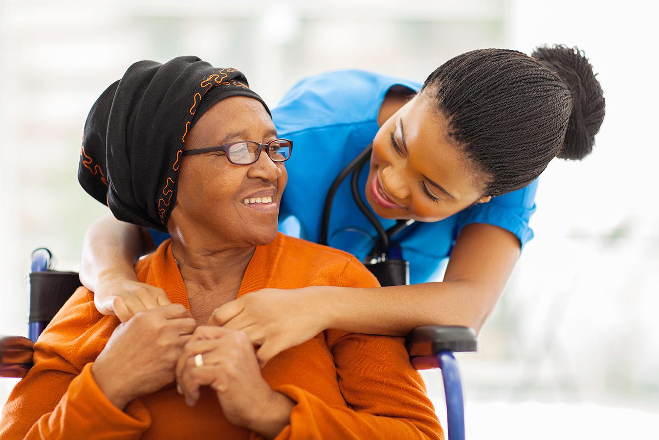 senior patient with female nurse
