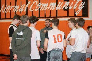 Gym teacher talks to students