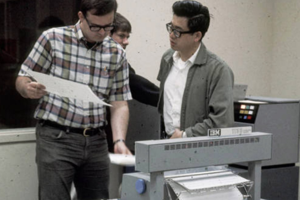 archive photo of people working at IBM computer in 1969