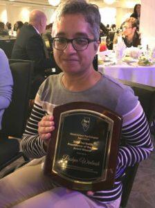 Illinois State alumna Pushpa Winbush, receives ISPA Practitioner of the Year Award.