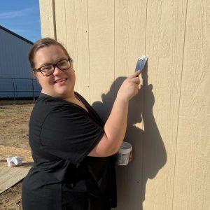 Woman scrapes building