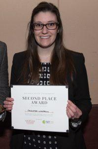 Jennifer Woodrum with award