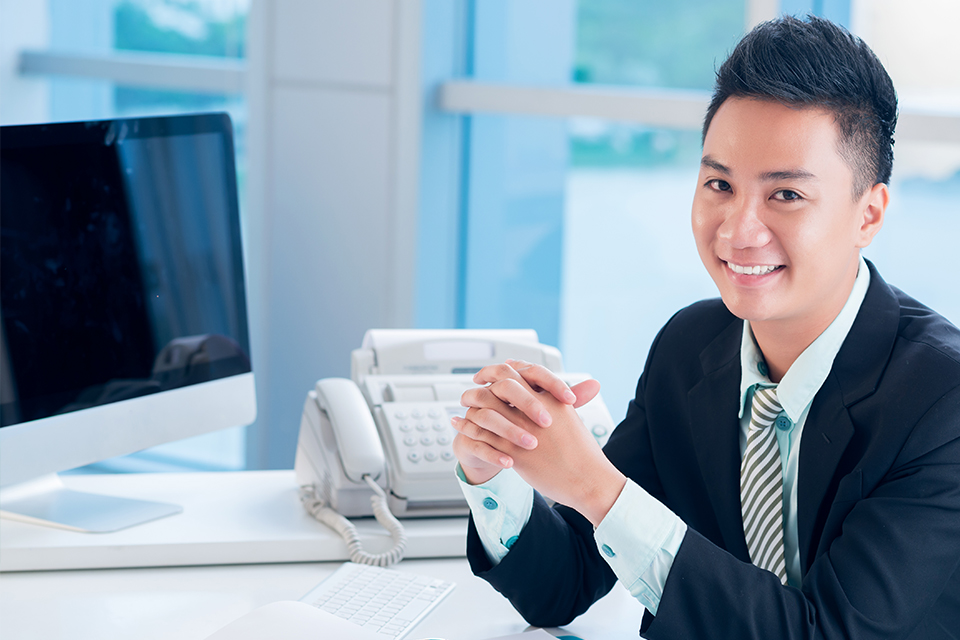 Person at a desk smiling