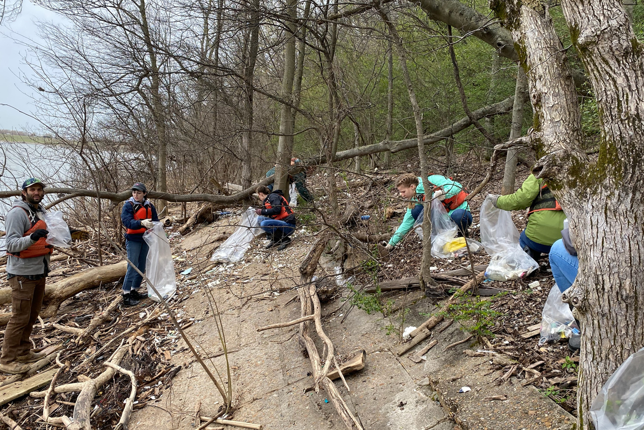 Students collecting trash