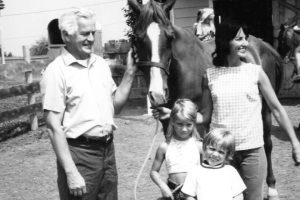 Four people with a horse