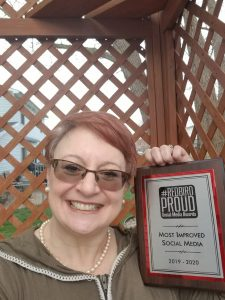 Susan Whitsitt with award