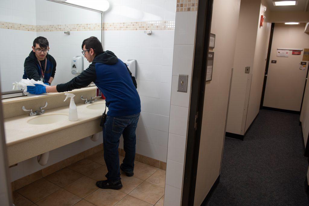 Man cleans mirrors