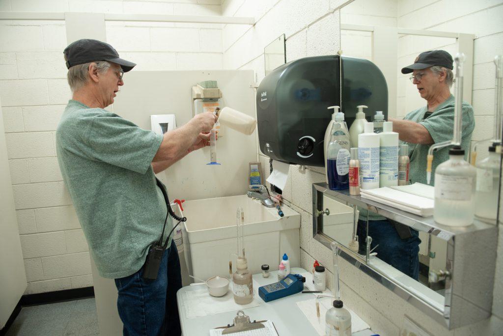 Man takes water samples