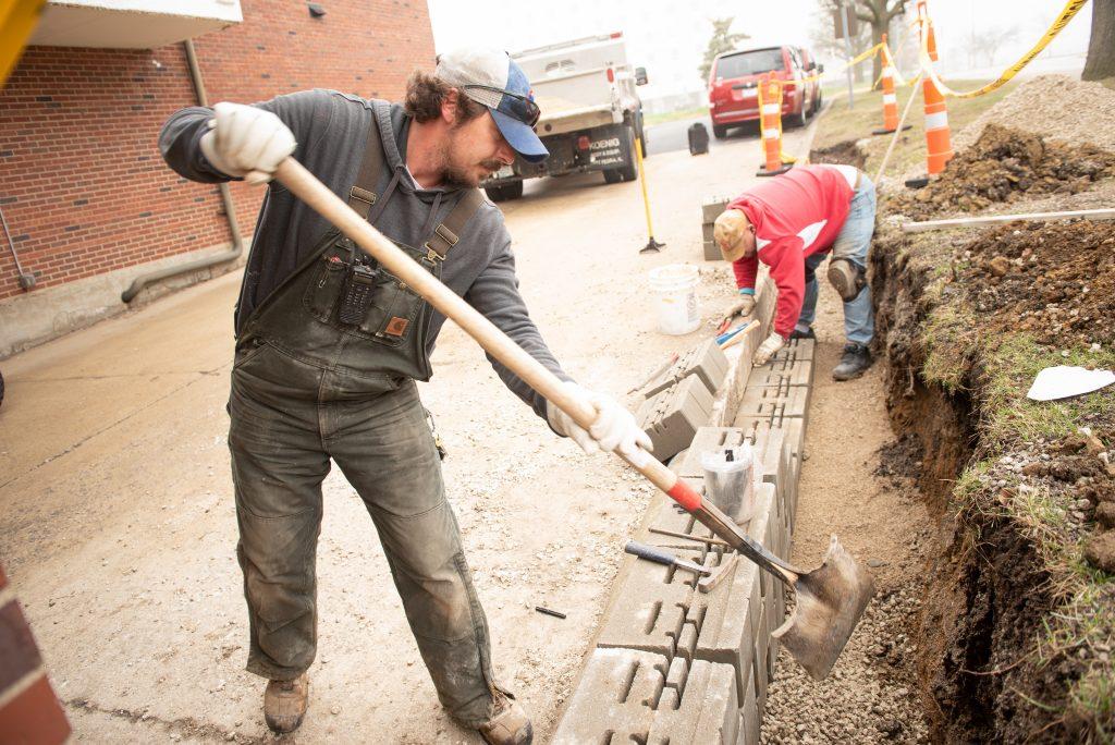 Men shoveling