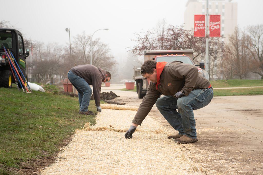 Men work on grounds