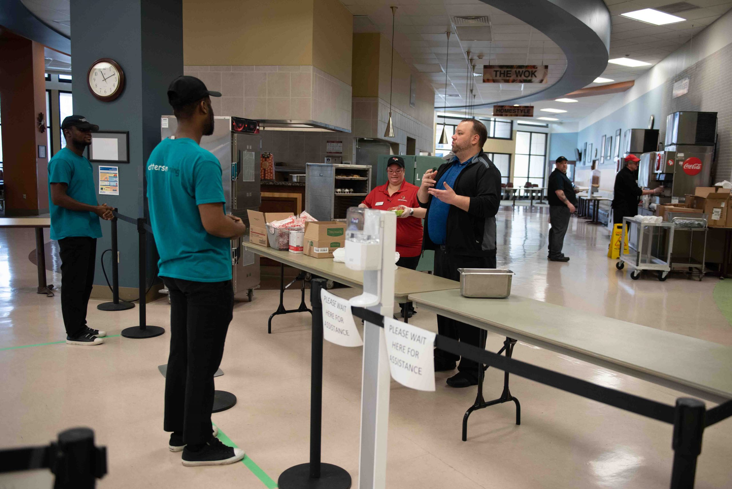Watterson Dining Commons Assistant Director Jay Laesch informs students about the lunch options available and process for picking them up.