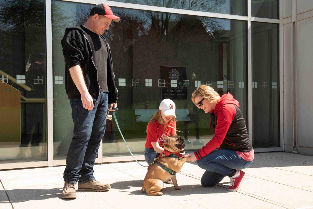 Family petting dog