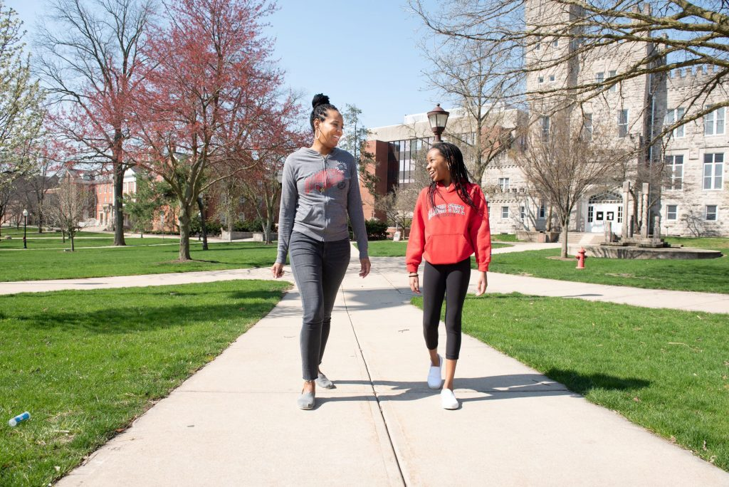 Mother and daughter walking on campus