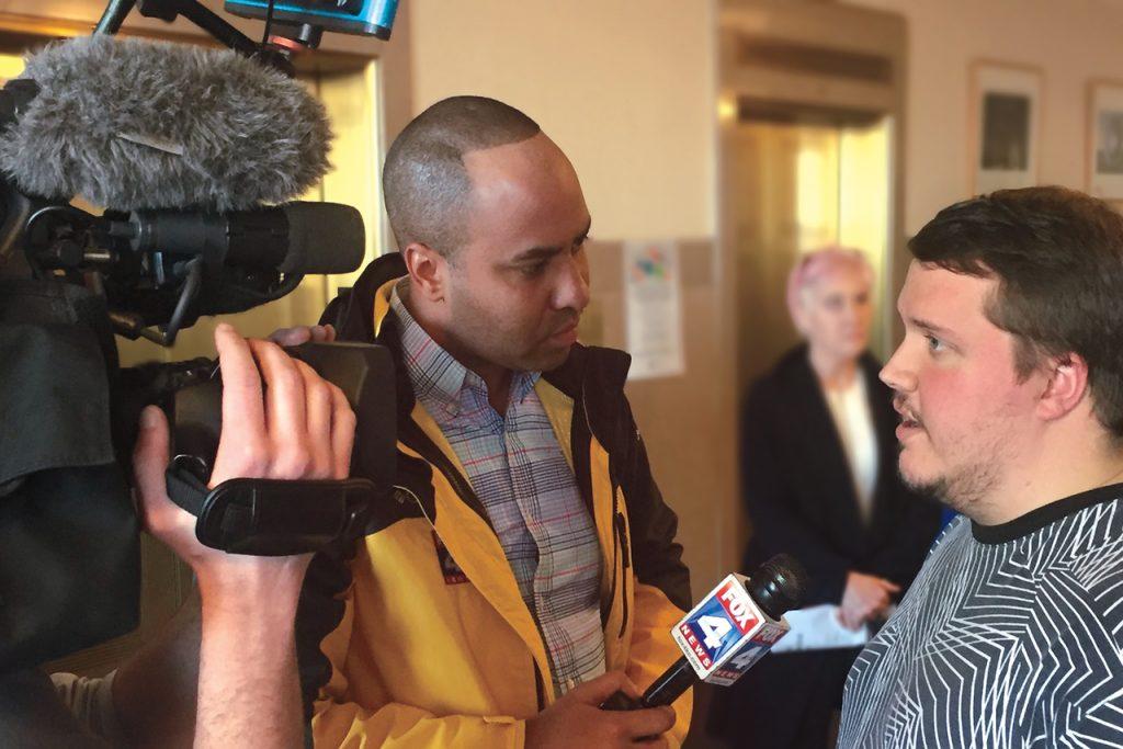 Man interviewing another man
