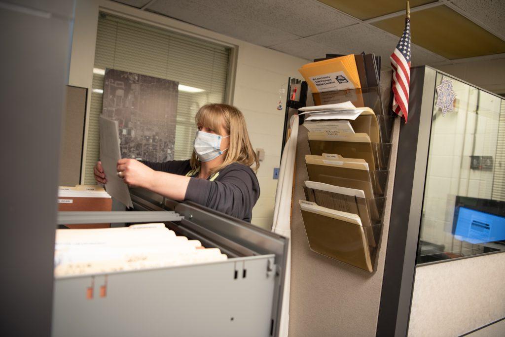 Woman filing paperwork