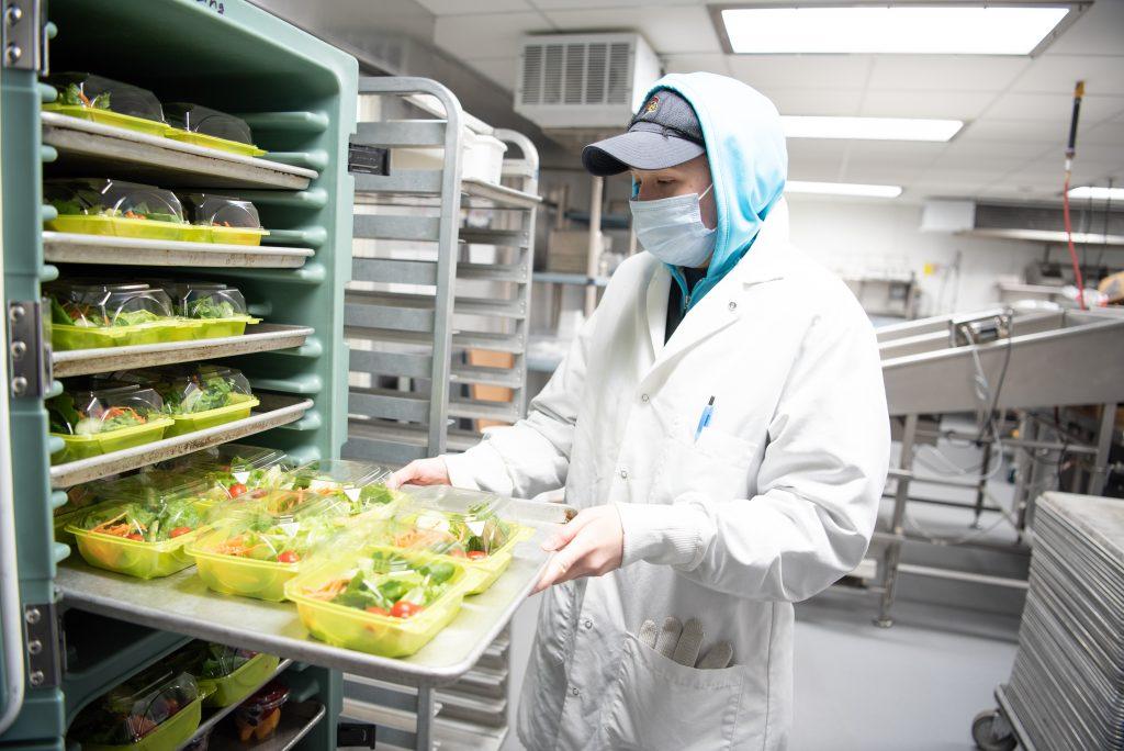 Man slide food into machine