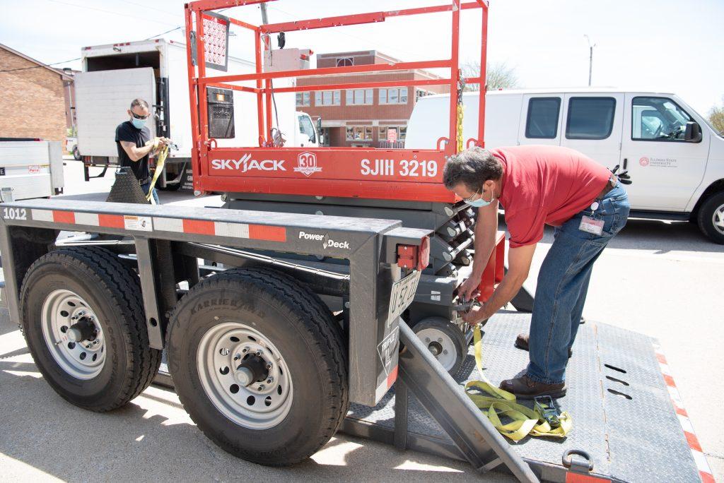Workers prepare equipment