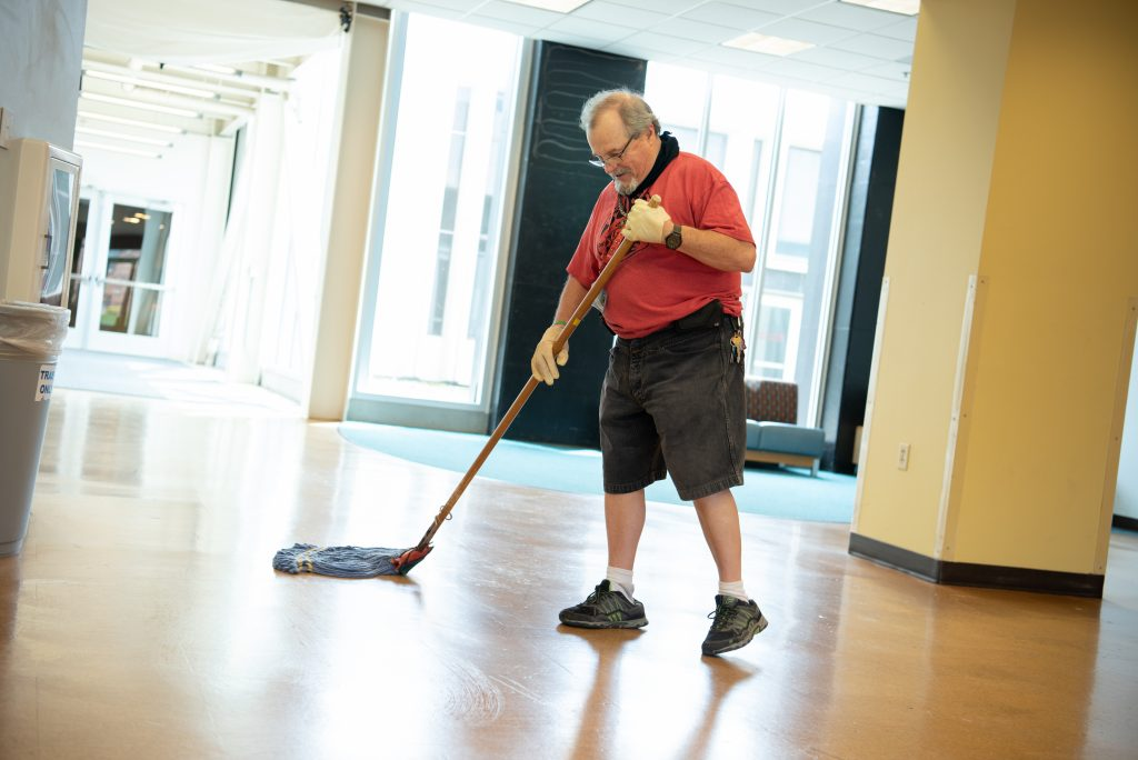 Man mops hall