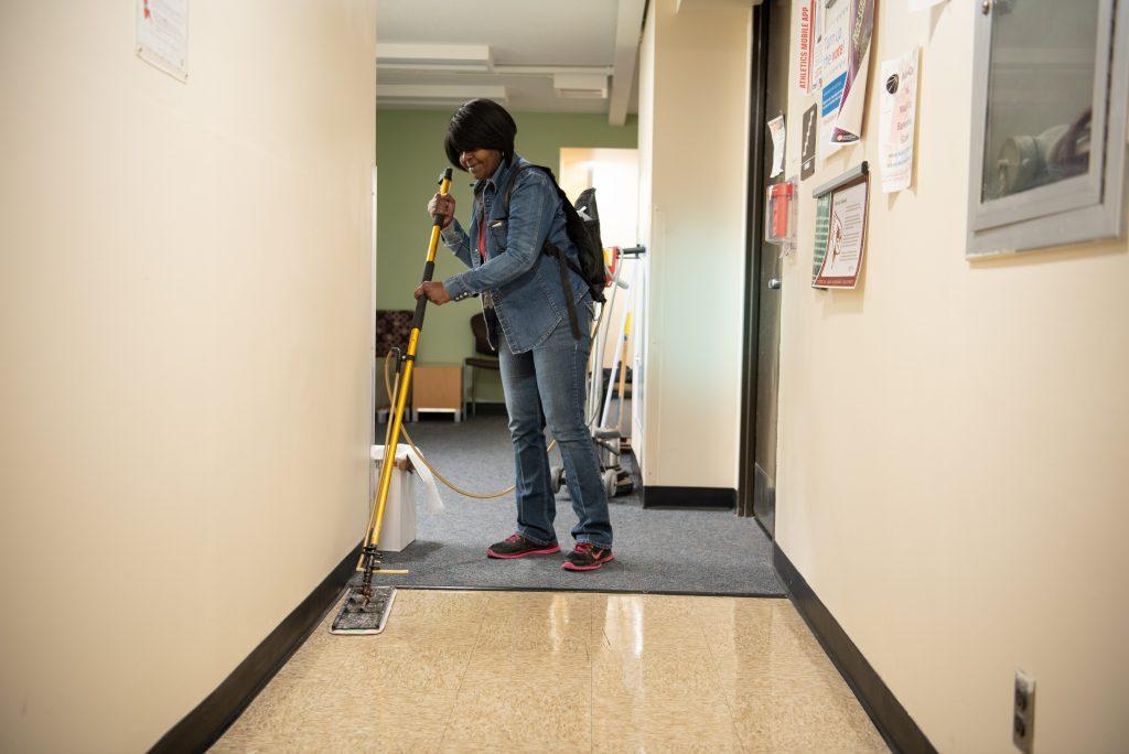 Woman waxing floor