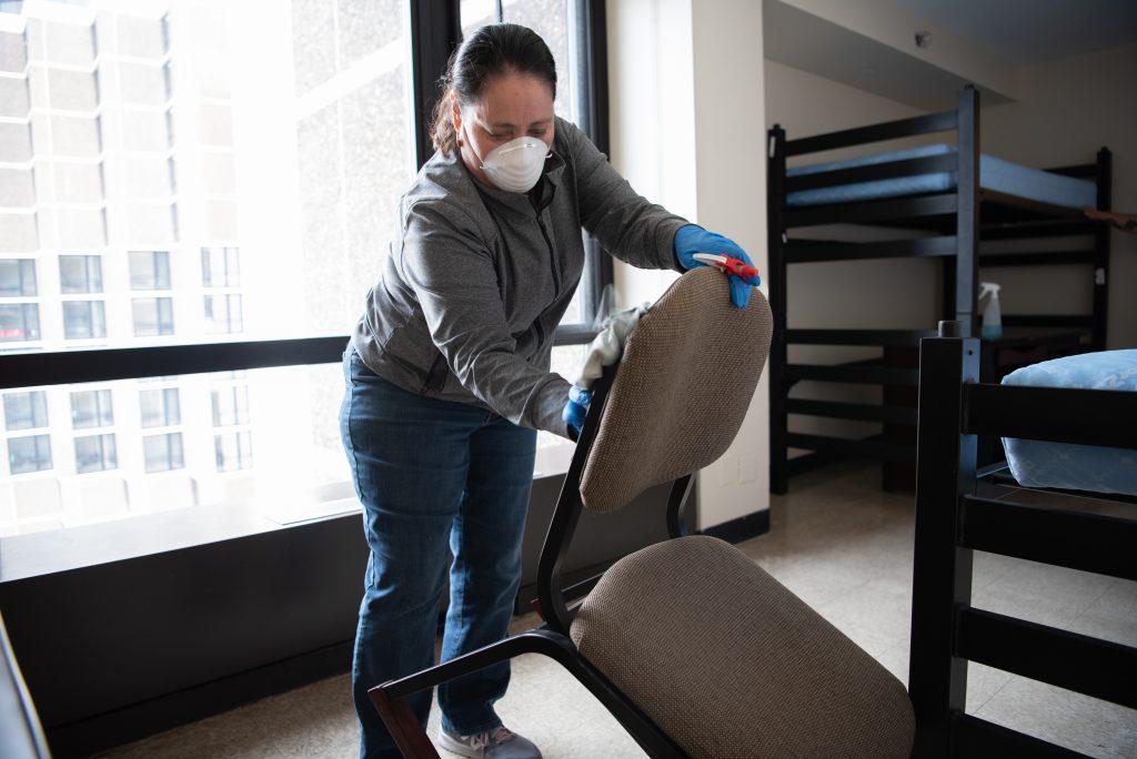 Woman sanitizing chairs