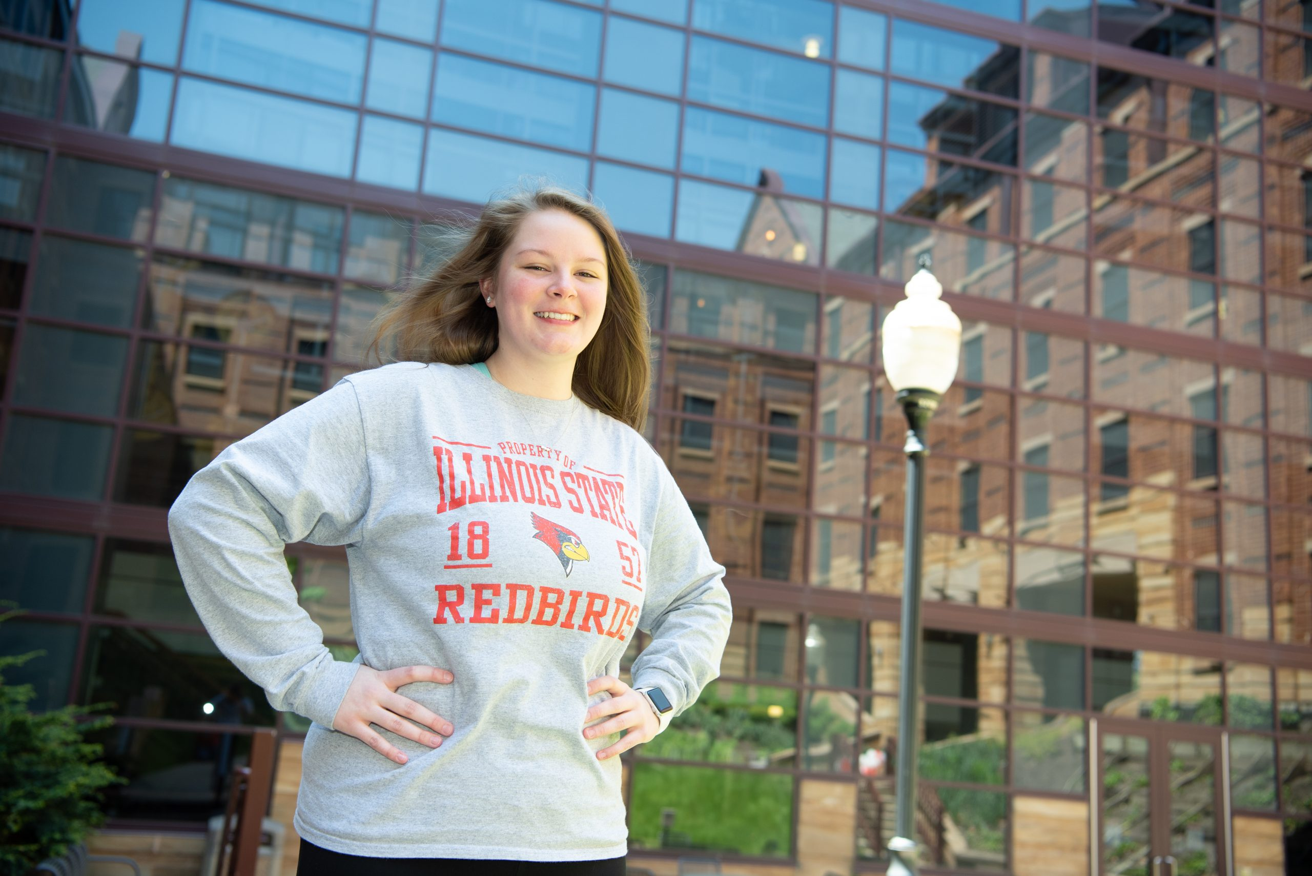 Hannah Quaid posing in front of State Farm Hall of Business