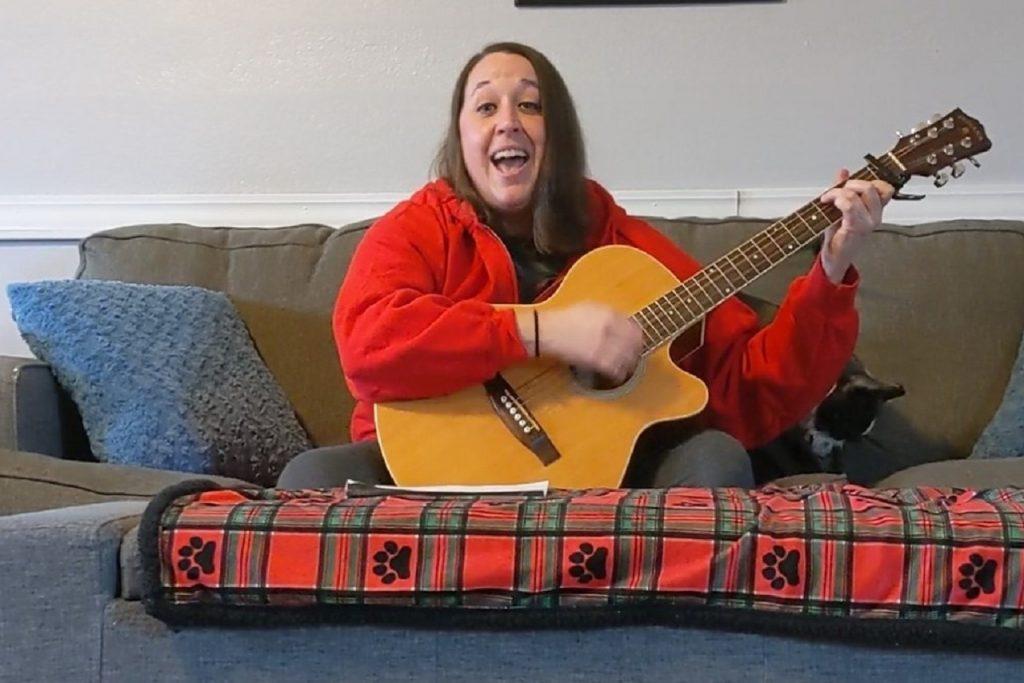 Woman playing guitar