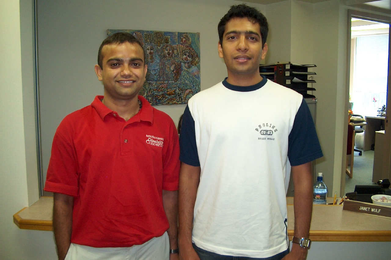 Two men standing next to each other