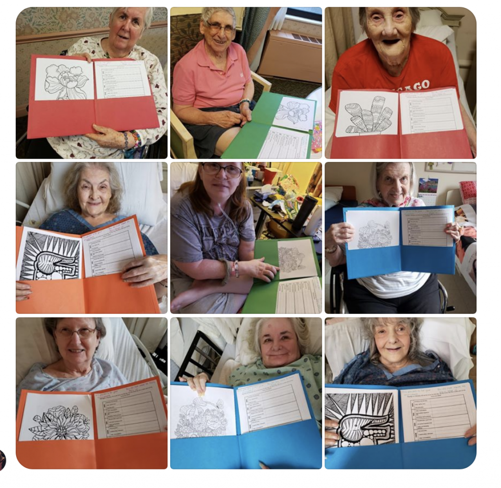 Residents at Alden Poplar Creek show their activity packets created by Illinois State therapeutic recreation students.