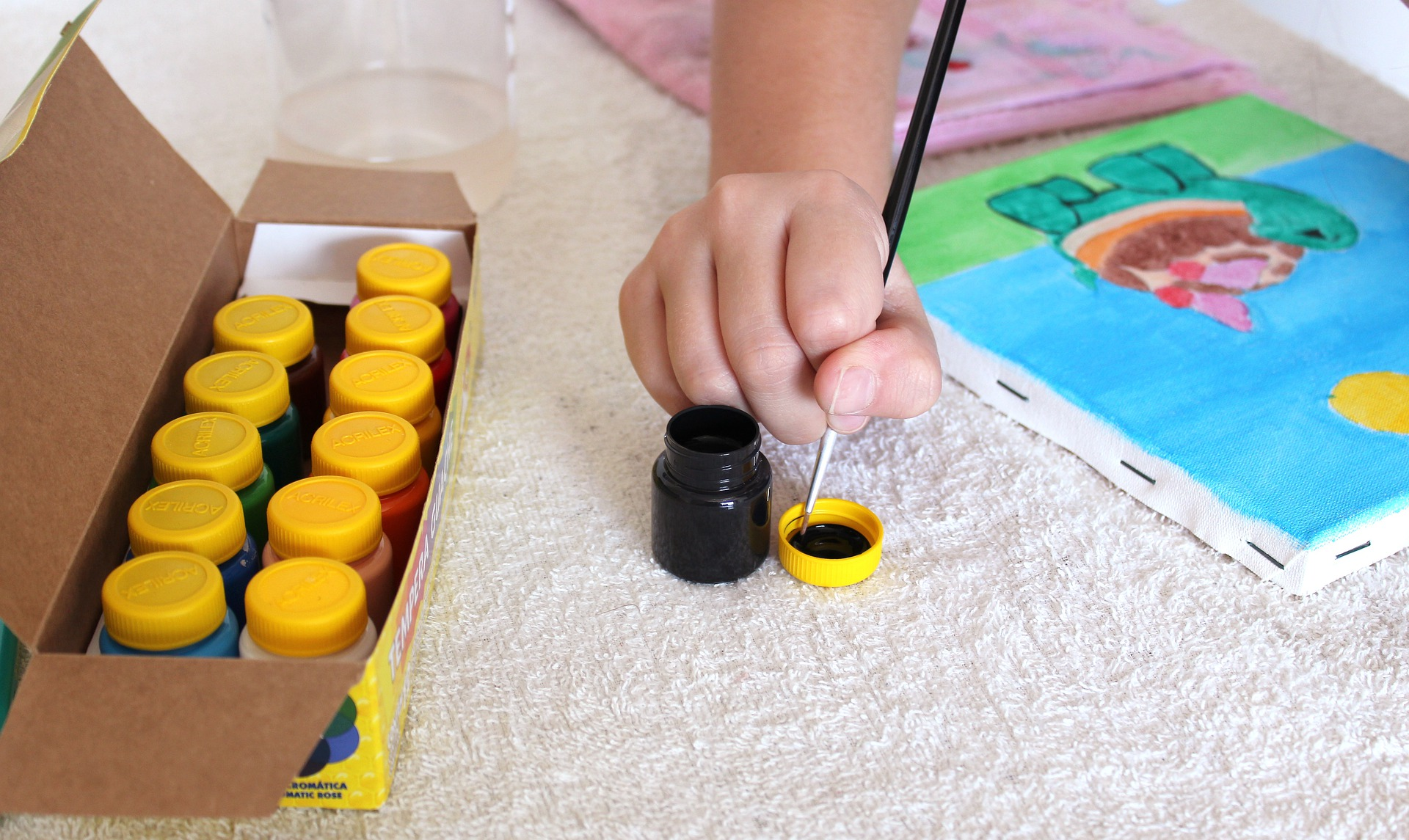 Child mixing paints