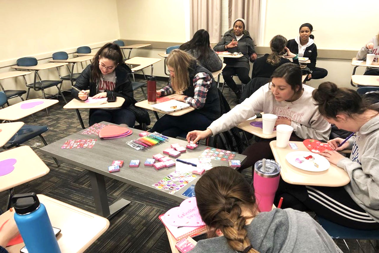 Group of women making cards during meeting