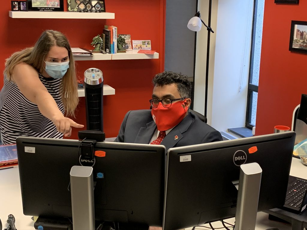 Technology Solutions employee Melinda Potter works with Technology Solutions Associate Vice President Charley Edamala on their first day back in Julian Hall.
