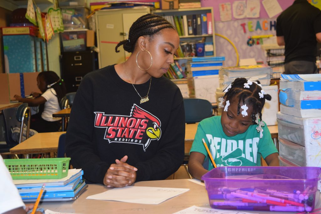 Student teacher working with a child