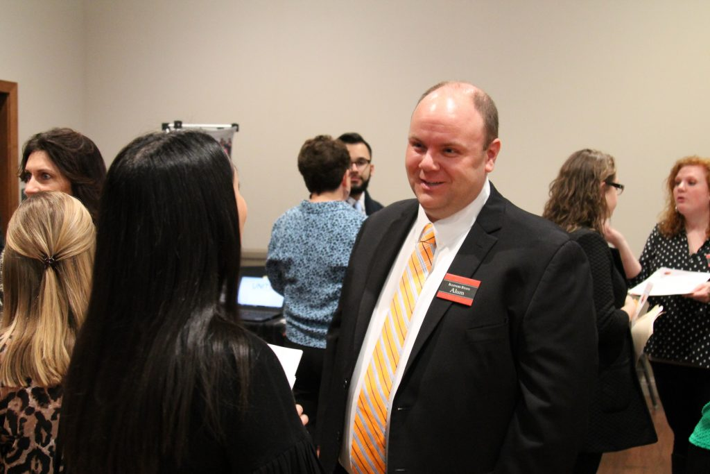 A doctoral candidate in conversation with student.
