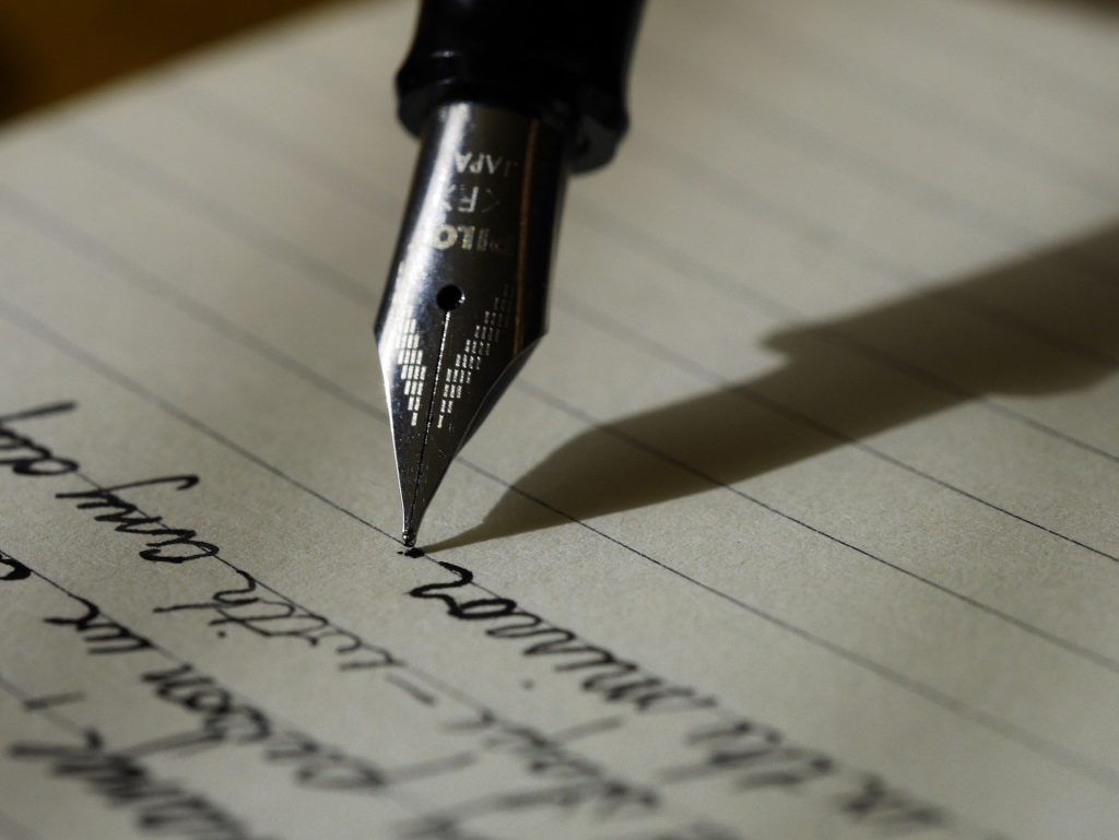 pen writing on paper