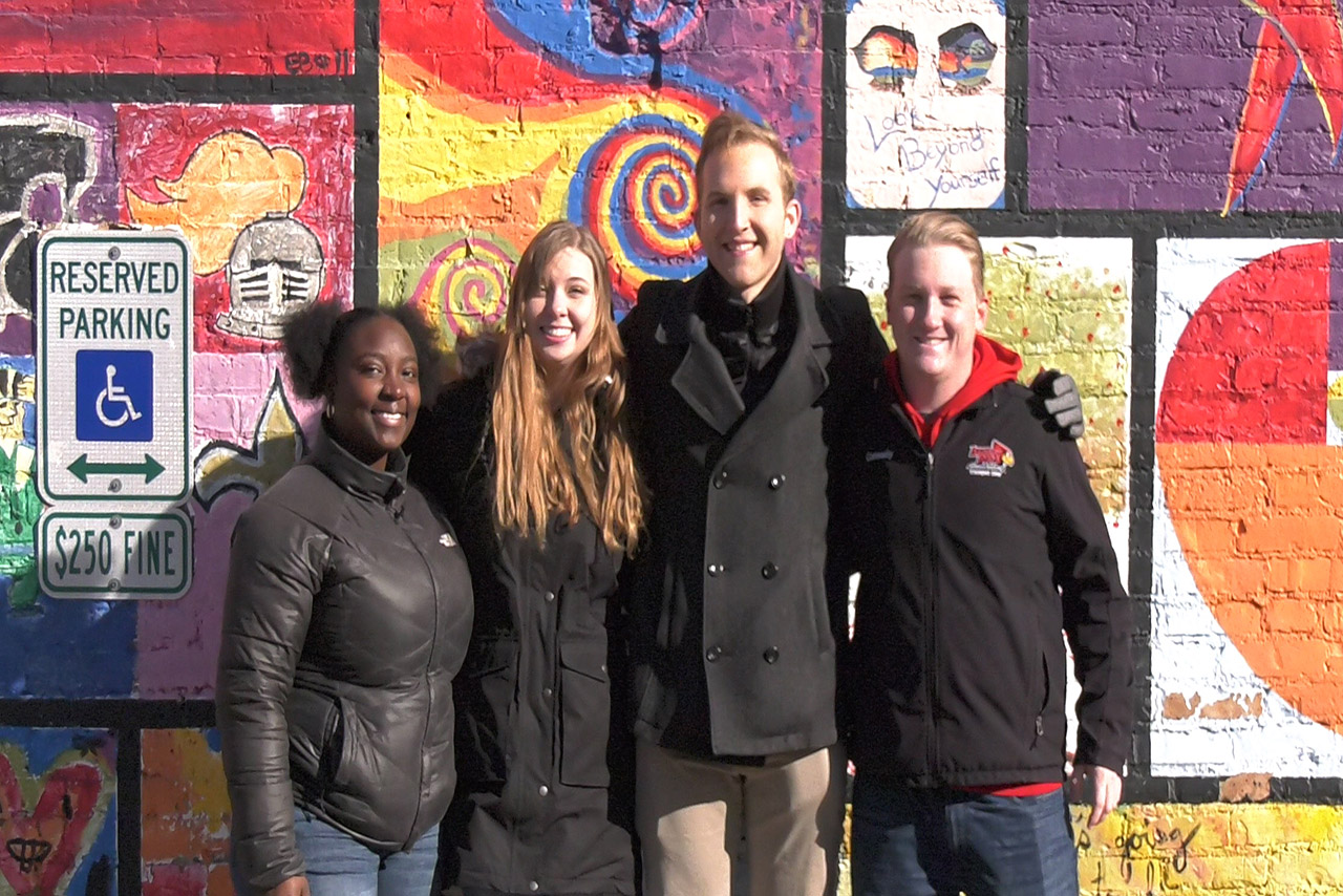 Students in front a mural